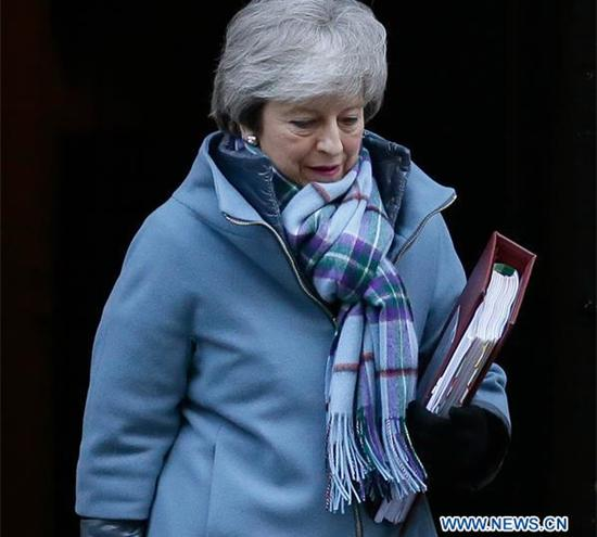 British Prime Minister Theresa May leaves 10 Downing Street for Prime Minister's Questions in the House of Commons in London, Britain, on Jan. 30, 2019. (Xinhua/Tim Ireland)