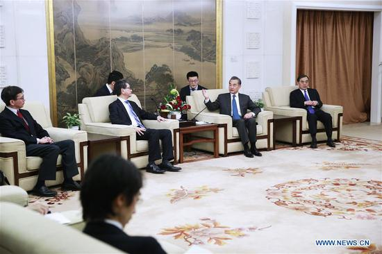 Chinese State Councilor and Foreign Minister Wang Yi (2nd R) meets with visiting Japanese Senior Deputy Minister for Foreign Affairs Takeo Mori in Beijing, capital of China, Feb. 2, 2019. Takeo Mori is here for a security dialogue and a regular diplomatic consultation between China and Japan. (Xinhua/Liu Bin)