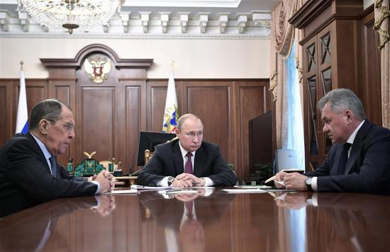 Russian President Vladimir Putin (C) meets with Defence Minister Sergei Shoigu (R) and Foreign Minister Sergei Lavrov in Moscow, Russia, on Feb. 2, 2019. Russian President Vladimir Putin said Saturday that Russia would not deploy medium-and-shorter-range missiles in any region as long as the United States avoids doing this. (Xinhua/Sputnik)
