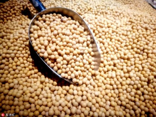 U.S. soybeans close moderately higher as China books more