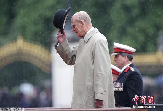 File photo of British Prince Philip (L)