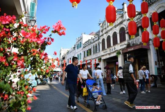 Tourists visit Qilou ancient street in Haikou, capital of south China's Hainan Province, Feb. 6, 2019, the second day of the Chinese Lunar New Year. (Xinhua/Guo Cheng)