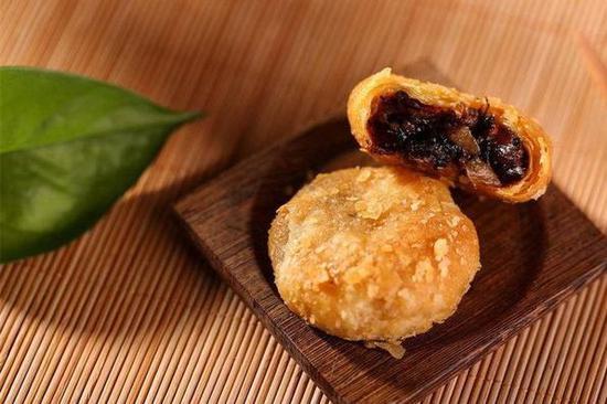Pancake-making skills handed down under watchful eye of inheritor