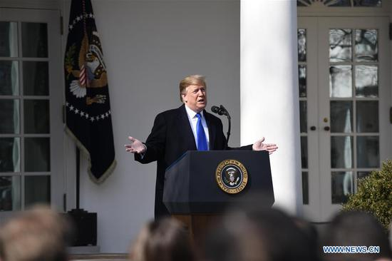 U.S. President Donald Trump speaks at the Rose Garden in the White House in Washington D.C., the United States, on Feb. 15, 2019. Trump announced Friday he will sign a national emergency to expand the U.S.-Mexico border wall and push for his signature campaign promise. (Xinhua/Hu Yousong)