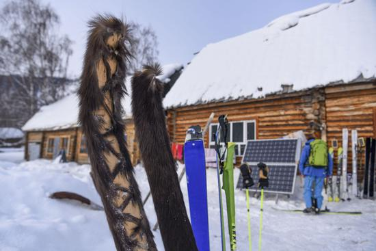 Ancient fur skis amaze European tourists on modern skis