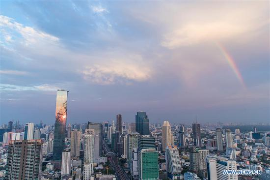 Rainbow appears in sky after rainfall in Bangkok, Thailand