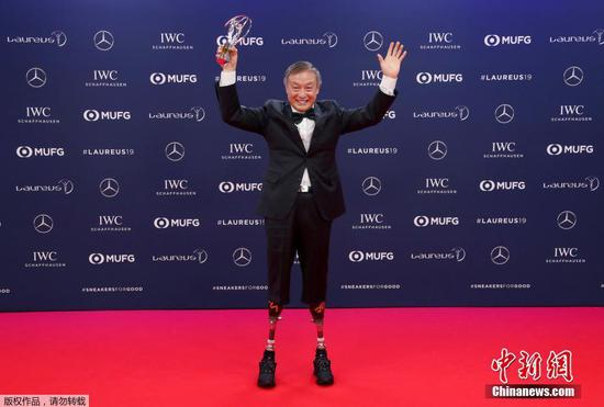 China's Xia Boyu, a double amputee who climbed Mount Everest, winner of the Laureus Sporting Moment of the Year celebrates at the 2019 Laureus World Sports Awards, Monday, Feb. 18, 2019.  (Photo/Agencies)
