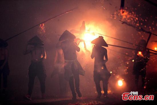Villagers perform for Lantern Festival celebration