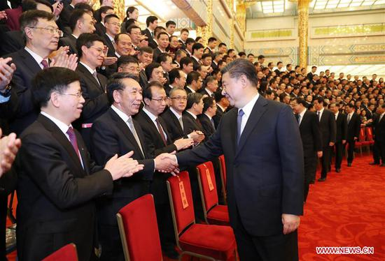 Chinese President Xi Jinping (R, front), also general secretary of the Communist Party of China Central Committee and chairman of the Central Military Commission, meets representatives of space scientists and engineers who participated in the research and development of the Chang'e-4 mission at the Great Hall of the People in Beijing, capital of China, Feb. 20, 2019. (Xinhua/Ju Peng)