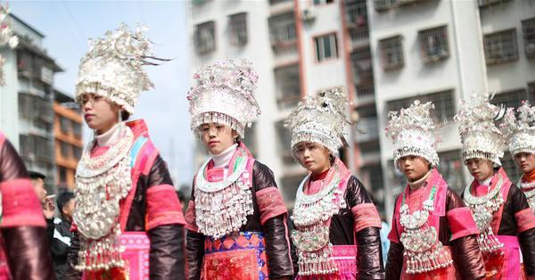Miao people dance to Lusheng to celebrate new life in SW China's Guizhou