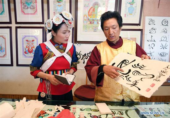 NPC deputy Fan Yongzhen dedicated to protecting, promoting local ethnic cultures