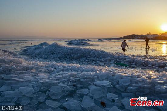 Ice in China-Russia border lake melts earlier this year