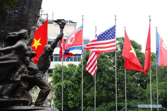 Photo taken on Feb. 25, 2019 shows national flags of Vietnam, the DPRK and the United States in Hanoi, Vietnam. The second summit between top leader of the Democratic People's Republic of Korea (DPRK) Kim Jong Un and U.S. President Donald Trump will be held in Hanoi on Feb. 27-28. (Xinhua/Wu Xiaochu)