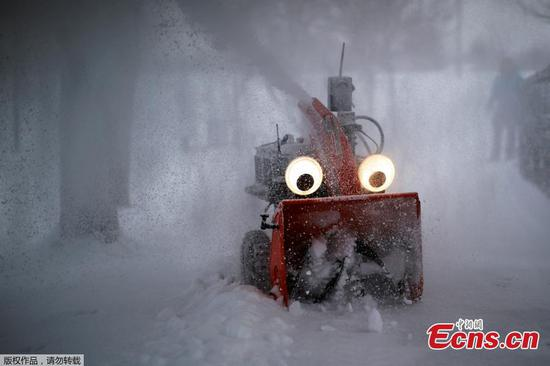 A GPS-guided snow blower called 'Chomper' clears snow in U.S.