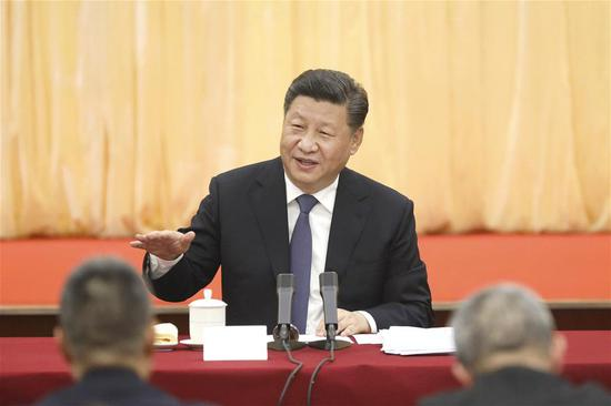 Chinese President Xi Jinping, also general secretary of the Communist Party of China (CPC) Central Committee and chairman of the Central Military Commission, visits political advisors from the sectors of culture and art, and social sciences who are attending the second session of the 13th National Committee of the Chinese People's Political Consultative Conference (CPPCC) in Beijing, capital of China, March 4, 2019. Xi joined them in a joint panel discussion and heard their opinions and suggestions. Wang Yang, a member of the Standing Committee of the Political Bureau of the CPC Central Committee and chairman of the CPPCC National Committee, also attended the discussion. (Xinhua/Sheng Jiapeng)