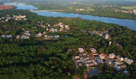 Aerial photo taken on May 30, 2018 shows the Yunlong Township in Haikou City, south China's Hainan Province.  (Xinhua/Zhao Yingquan)