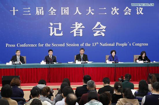 China's Minister of Finance Liu Kun (C), and vice ministers Cheng Lihua (2nd R) and Liu Wei (2nd L) attend a press conference on the country's fiscal and tax reforms and fiscal work for the second session of the 13th National People's Congress in Beijing, capital of China, March 7, 2019. (Xinhua/Shen Bohan)