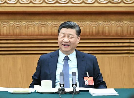 Chinese President Xi Jinping, also general secretary of the Communist Party of China (CPC) Central Committee and chairman of the Central Military Commission, joins deliberation with deputies from central China's Henan Province at the second session of the 13th National People's Congress in Beijing, capital of China, March 8, 2019. (Xinhua/Xie Huanchi)