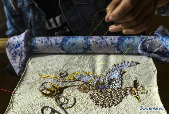 Pic story of embroiderer in NW China's Xinjiang