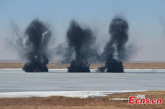 Ice-clearing methods practiced in Inner Mongolia drill