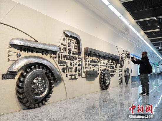 Auto parts turned to decoration at Changchun metro station