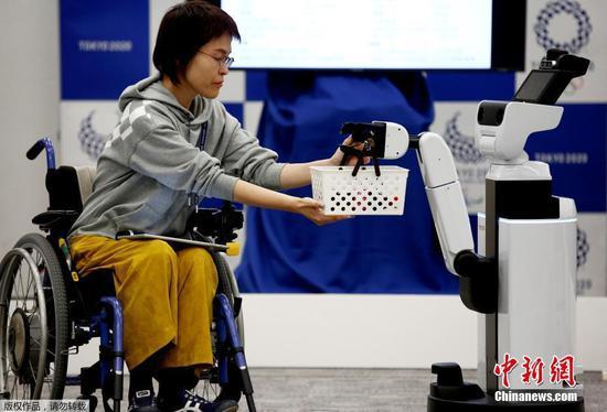 Japan unveils robot volunteers for 2020 Tokyo Olympics
