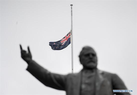 New Zealand's national flag flies at half-mast in Wellington