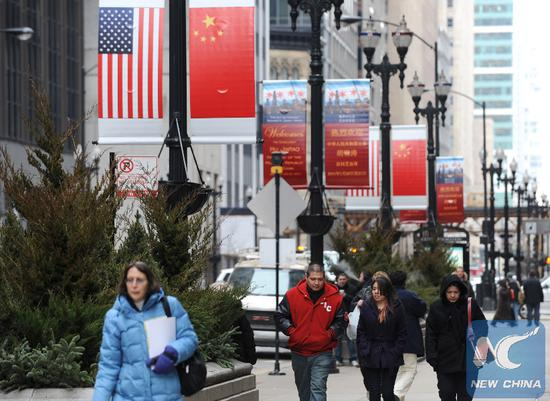 FILE PHOTO: Residents walk in the street in Chicago, U.S., on Jan. 19, 2011. (Xinhua/Shen Hong)