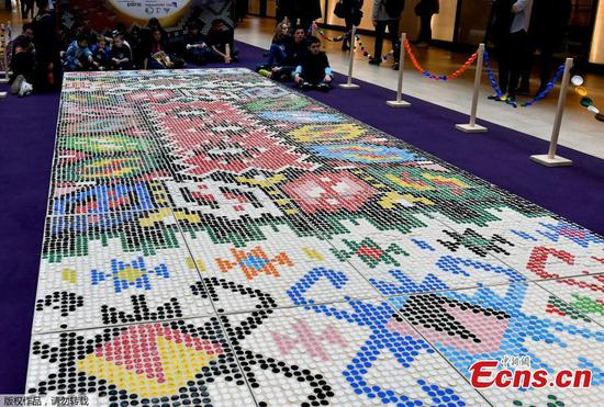 Bosnian carpet, made of 25,000 plastic plugs, marks Global Recycling Day