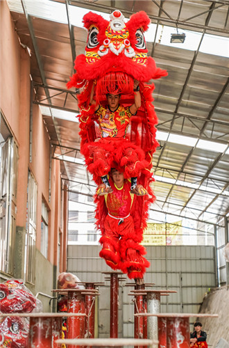 Lion dance performers blend acrobatic stunts