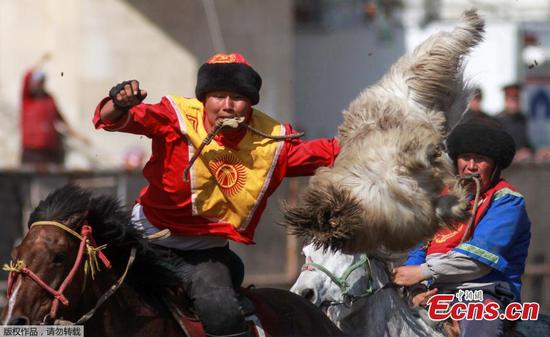 Goat dragging competition marks spring equinox in Kyrgyzstan