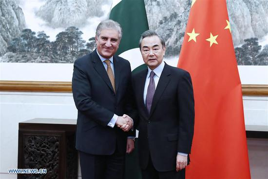 Chinese State Councilor and Foreign Minister Wang Yi (R) and Pakistani Foreign Minister Shah Mahmood Qureshi co-chair the first strategic dialogue between foreign ministers of China and Pakistan in Beijing, capital of China, March 19, 2019. (Xinhua/Liu Bin)