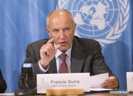 World Intellectual Property Organization (WIPO) Director General Francis Gurry (C) speaks during a press conference in Geneva, Switzerland, March 18, 2019. Chinese telecoms giant Huawei Technologies was the top corporate filer of international patent applications in 2018, leading an Asia-based innovation surge accounting for over half of the applications submitted at the WIPO last year, WIPO said on Tuesday. (Xinhua/Xu Jinquan)