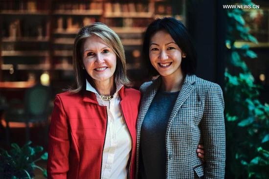 Yang Mu (R), the first recipient of the Sister City Scholarship, which allows Tianjin high school graduates to study at Drexel University, poses for a photo with Nancy Gilboy, former head of the Citizen Diplomacy International (CDI), during an interview with Xinhua in Philadelphia, the United States, March 13, 2019. (Xinhua/Li Muzi)