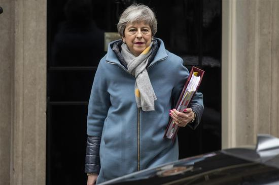 British Prime Minister Theresa May leaves 10 Downing Street for the Prime Minister's Questions in the House of Commons in London, Britain, March 20, 2019. (Xinhua/Ray Tang)