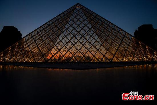 Louvre Pyramid lights up for its 30th anniversary