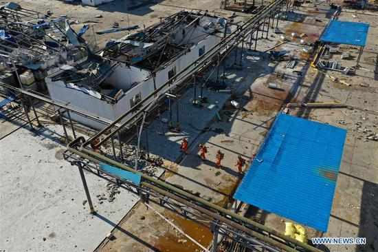 Aerial photo taken on March 22, 2019 shows firefighters working at the site of a factory explosion at a chemical industrial park in Yancheng, east China's Jiangsu Province. (Xinhua/Ji Chunpeng)