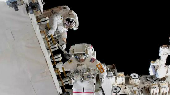 Two astronauts make a 6.5-hour spacewalk to swap batteries