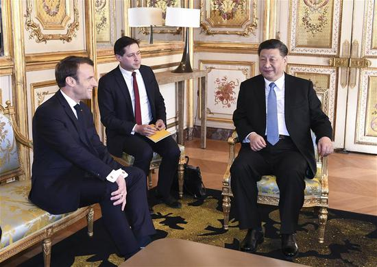 Xi holds talks with Emmanuel Macron