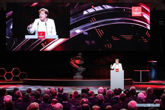 German Chancellor Angela Merkel delivers a speech during the opening ceremony of 2019 Hanover Fair in Hanover, Germany, on March 31, 2019. The Hanover Fair, the world's largest industrial show, opened here on Sunday evening with the highlights of 5G network and artificial intelligence (AI). (Xinhua/Shan Yuqi)
