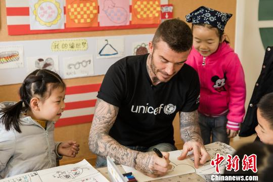 UNICEF Goodwill Ambassador David Beckham plays with children during a visit to Xianghuaqiao Kindergarten in Shanghai, China, March 27, 2019. (Photo provided by UNICEF)