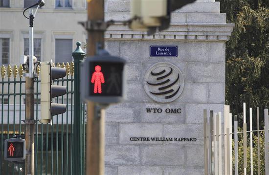 Photo taken on April 2, 2019 shows the WTO logo on the main gate of the World Trade Organization (WTO) in Geneva, Switzerland. (Xinhua/Xu Jinquan)