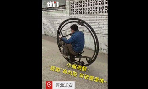 Villager creates ��Men in Black�� sci-fi bike