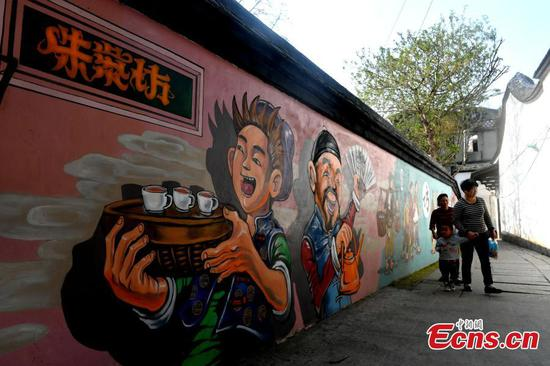 Colourful murals decorate historic block in Zhuzifang
