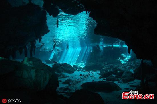 Amazing sunlight effects at cenote diving in Mexico