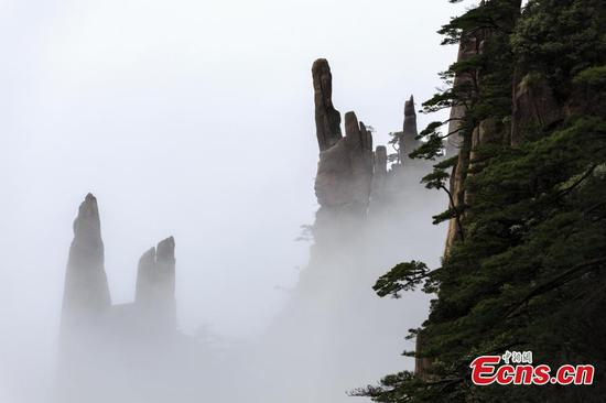 Clouds roll across Mount Huang