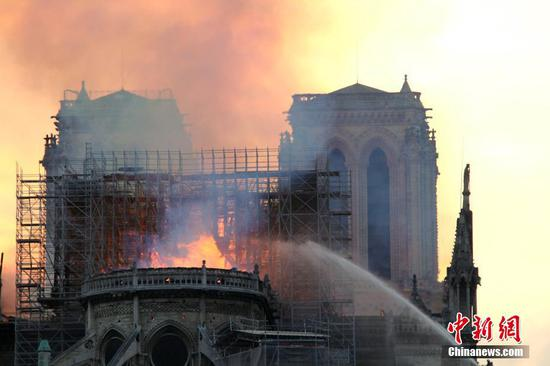 Smoke rises from the Notre Dame Cathedral in central Paris, capital of France, on April 15, 2019. A blaze broke out on Monday afternoon at the Notre Dame Cathedral in central Paris where firefighters were still fighting to put the fire under control, Paris Mayor Anne Hidalgo said. (Photo/Agencies)