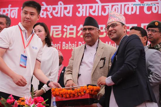 Nepalese Prime Minister KP Sharma Oli (C) attends the ceremony celebrating the breakthrough of the 12.2 km tunnel of Bheri Babai Diversion Multipurpose Project (BBDMP) in Surkhet district of Karnali Province in western Nepal, on April 16, 2019.  (Xinhua/Zhou Shengping)