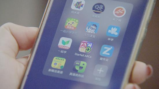 Parents need to install several study apps on the smartphone of their child, some of which are required by schools. (CGTN Photo)