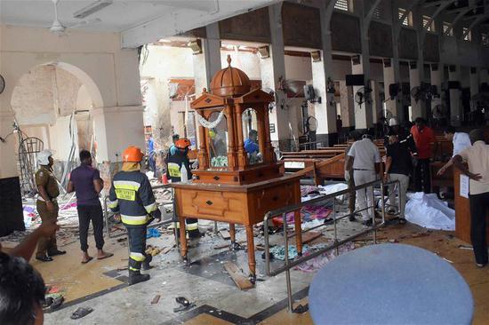 People work at a blast scene at St. Anthony's Church in Kochchikade in Colombo, Sri Lanka, April 21, 2019. (Xinhua)